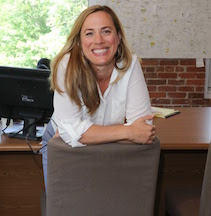 Woman smiling in an office.