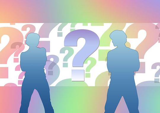 Two silhouettes of a man and woman with their arms crossed surrounded by giant question marks in multiple colors.